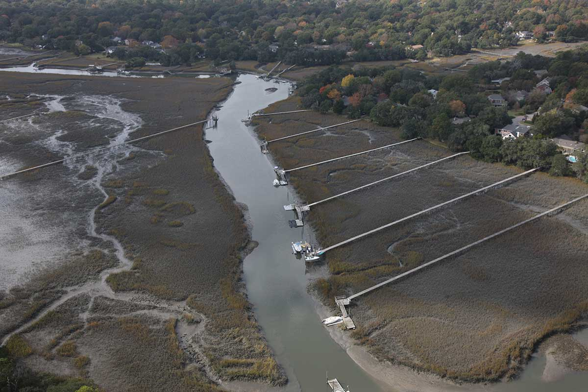 Aerial view of a salt marsh buffer between a tidal creek and surrounding development