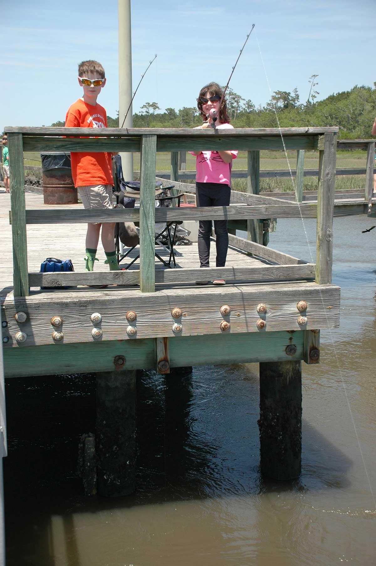 Children fishing off of a public dock.