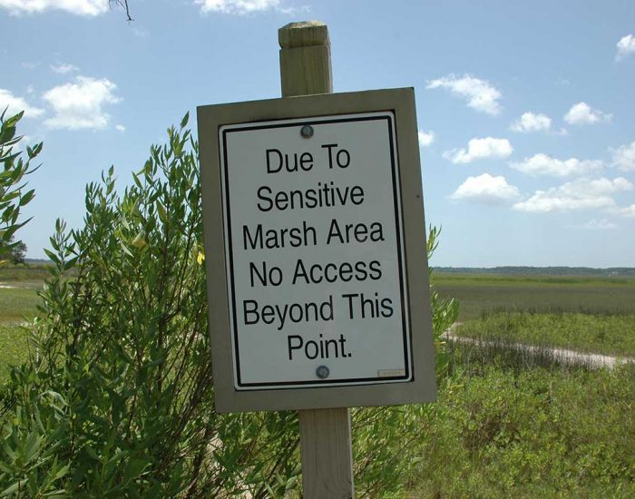 Sign promoting marsh protection. It says: Due to Sensitive Marsh Area No Access Beyond this Point.